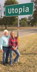 Lona and Larry with the Utopia town sign